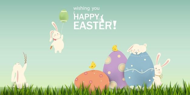 Coniglietto felice del coniglio di pasqua di pasqua con le uova sul modello della bandiera del campo di erba