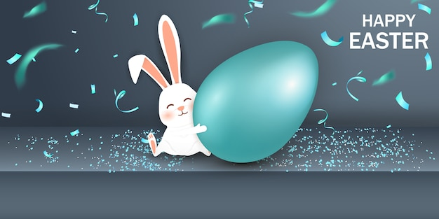 Buona pasqua. coniglietto di pasqua coniglio con realistico uovo blu su sfondo grigio. simpatico personaggio dei cartoni animati conigli pasquali.