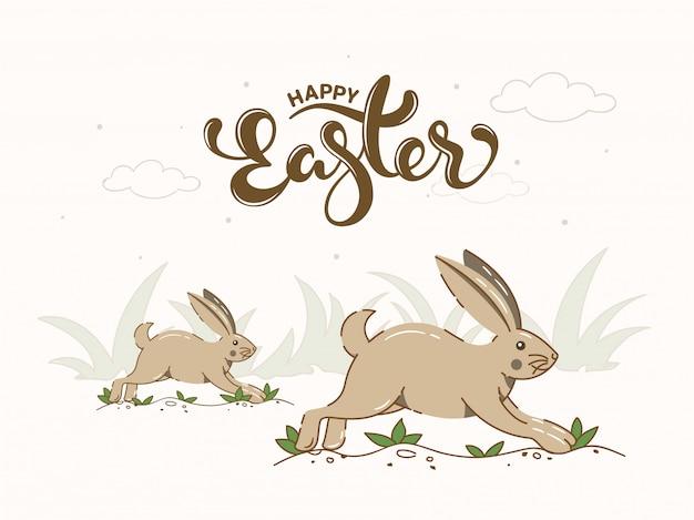 Fonte tipografica felice di pasqua con i conigli del fumetto che corrono sull'erba