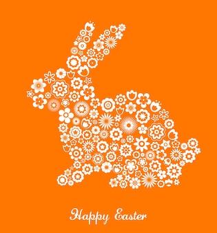 Cartolina d'auguri di pasqua felice con coniglietto e fiori