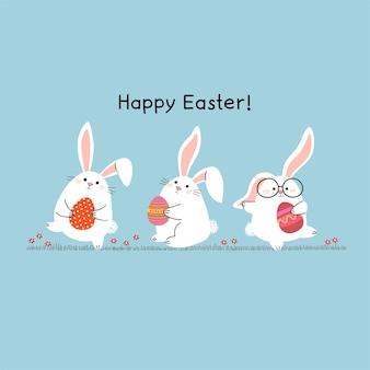 Cartolina d'auguri di pasqua felice con i coniglietti di pasqua