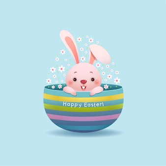 Cartolina d'auguri di pasqua felice con il coniglietto di pasqua e l'uovo