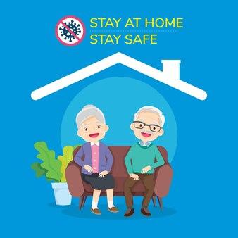Felice coppia di anziani seduti a casa per prevenire il virus covid-19