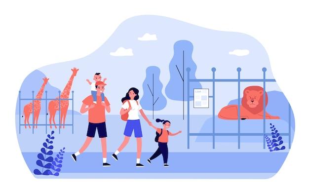 Coppia famiglia felice con bambini eccitati che camminano nello zoo