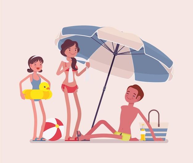 La famiglia felice gode del resto all'illustrazione della spiaggia