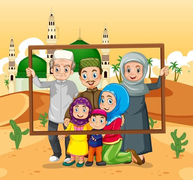 Famiglia felice che tiene la cornice per foto con la moschea sullo sfondo