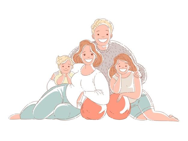 Famiglia felice che si siede sul pavimento e sorridente