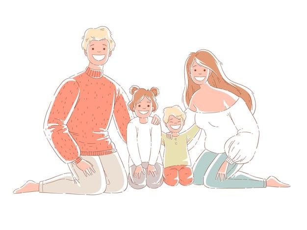 Famiglia felice che si siede sul pavimento