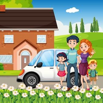 Famiglia felice in piedi davanti alla casa