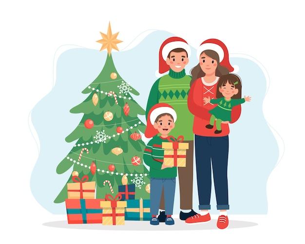 Famiglia felice con l'albero di natale