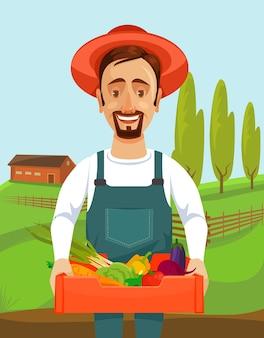 L'agricoltore felice tiene la scatola con l'illustrazione delle verdure