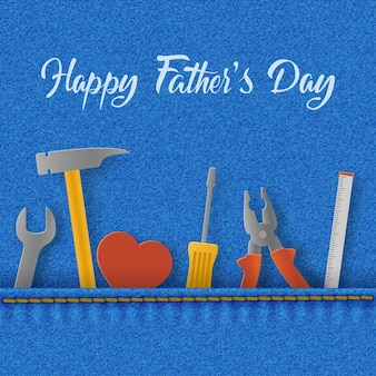 Biglietto per la festa del papà con cuore e strumenti nella tasca del denim, chiave inglese, martello e cacciavite.