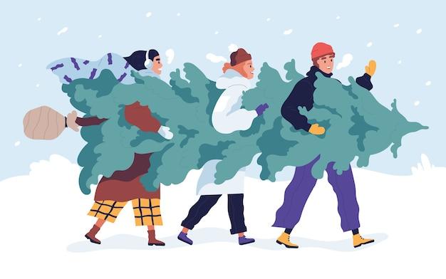 Amici felici che trasportano albero di natale
