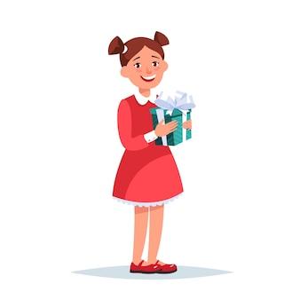Ragazza felice in abito rosso con un regalo in mano