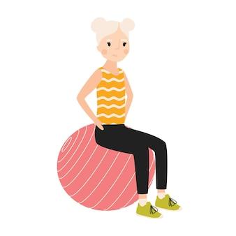 Felice ragazza seduta su ginnastica o equilibrio palla e l'esecuzione di esercizio isolato