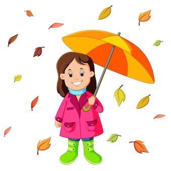 Ragazza felice sotto l'ombrello
