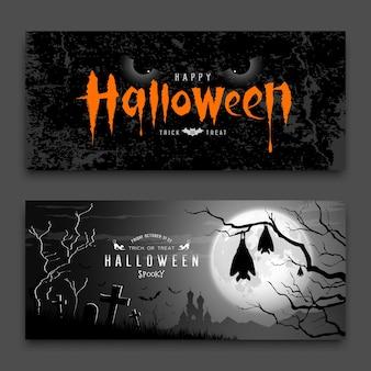 Occhi del diavolo di halloween felici e pipistrello addormentato nell'albero sulle collezioni di sfondo di notte di luna