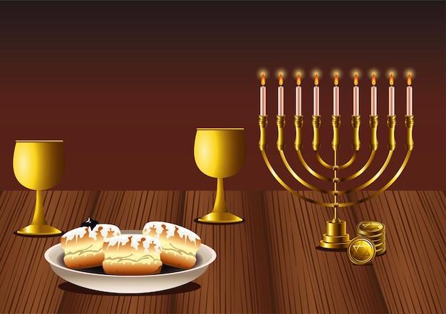 Felice festa di hanukkah con lampadario e ciambelle in un tavolo di legno