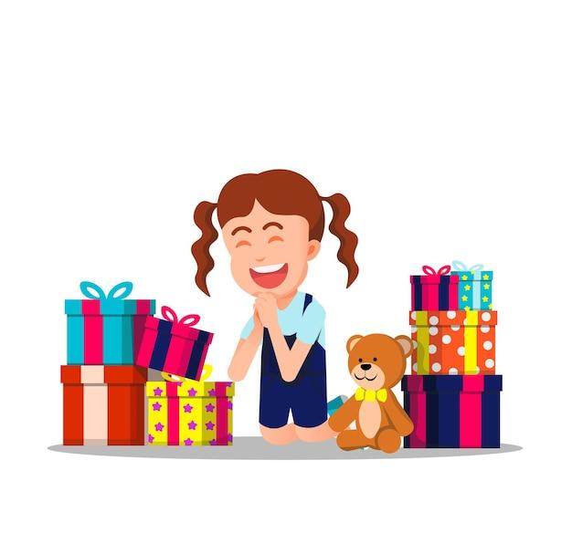 La bambina felice riceve molte scatole regalo