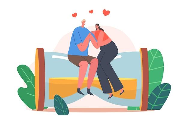 Felice coppia amorosa di uomo e donna che si tengono per mano, abbracciando la seduta su un'enorme clessidra. gioiosa relazione amante, incontri