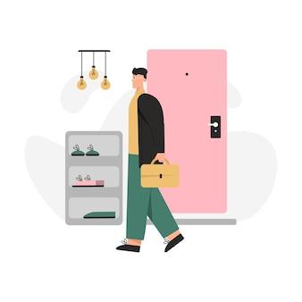 L'uomo felice torna a casa dal lavoro e in piedi nell'accogliente scena del corridoio.