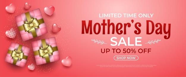 Bandiera di giorno di madri felice con cuori e confezione regalo sul rosa