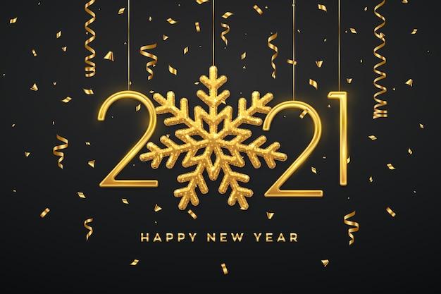 Felice anno nuovo 2021. numeri metallici dorati appesi 2021 con fiocco di neve splendente e coriandoli su sfondo nero.