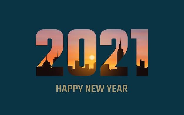Felice anno nuovo 2021 con alba e silhouette sullo sfondo dell'orizzonte della città