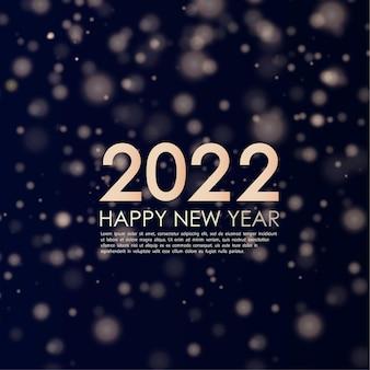 Felice anno nuovo 2022 elegante testo retroilluminato oro testo minimalista polvere d'oro biglietto di auguri