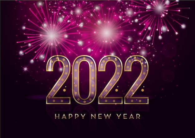 Felice anno nuovo 2022 e fuochi d'artificio con spazio di testo su uno sfondo colorato che celebra il nuovo anno