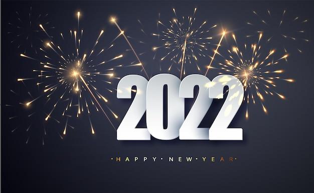 Felice anno nuovo 2022. saluto anno nuovo banner con numeri data 2022 sullo sfondo dei fuochi d'artificio.