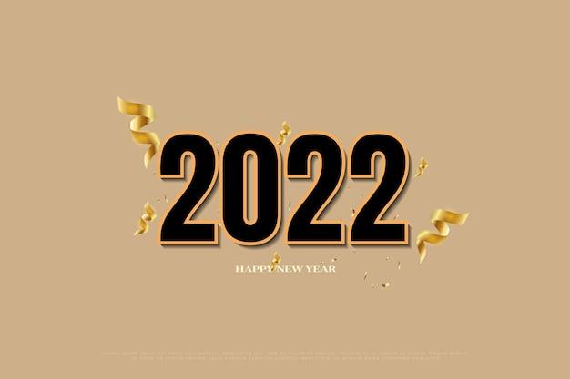 Felice anno nuovo 2022 con nastro dorato e sfondo glitter oro