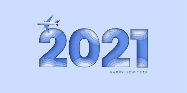 Felice anno nuovo design blu. numero di carta tagliata con aereo e nuvole
