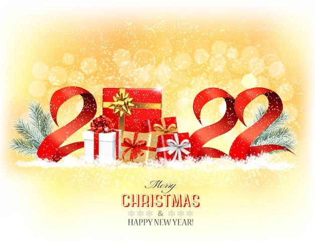 Felice anno nuovo e sfondo per le vacanze di natale con un 2022 e scatole regalo e nastri vector
