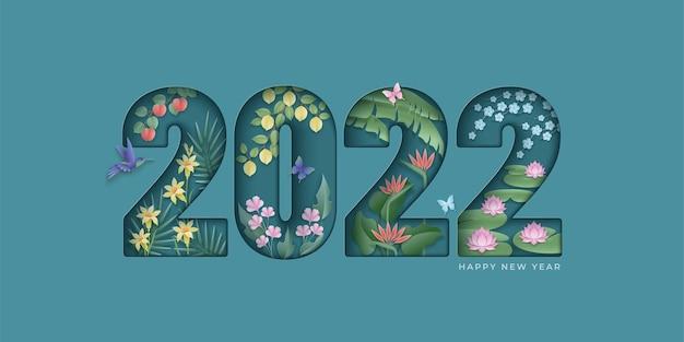 Felice anno nuovo sfondo elegante carta tagliata numero 2022 con piante tropicali