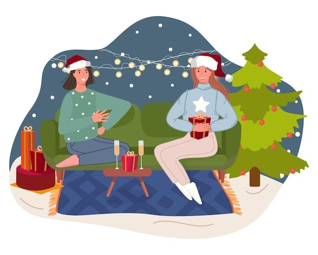 Felice anno nuovo persone che celebrano le vacanze invernali donne sedute sul divano accanto all'albero di natale