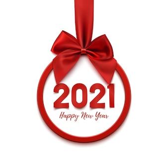 Felice anno nuovo rotondo astratto banner con nastro rosso e fiocco, isolato sulla bandiera bianca.