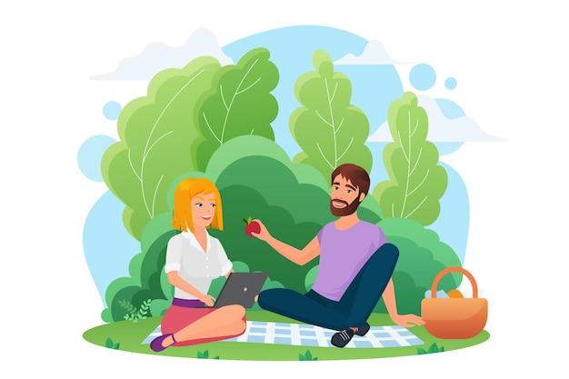 Coppia di persone felici che si incontrano nel parco picnic insieme