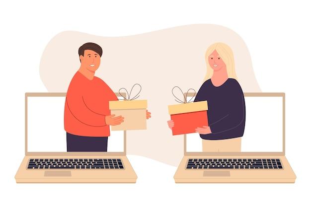 Gente felice. fatevi regali a vicenda. una donna fa un regalo a un uomo tramite laptop. il ragazzo fa un regalo alla ragazza. sorpresa di vacanza. celebrare il natale. beneficenza. coppie che danno e tengono regali.