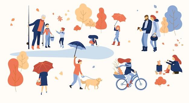 Le persone felici trascorrono il tempo libero all'aperto nel parco autunno