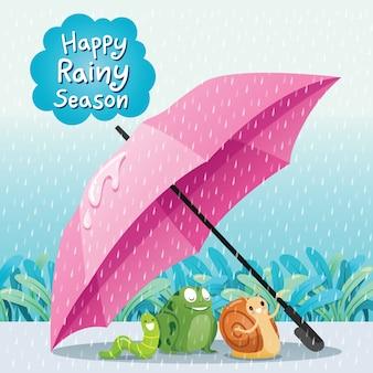Felice stagione delle piogge, lumaca, rana e verme sotto l'ombrello a terra insieme sotto la pioggia