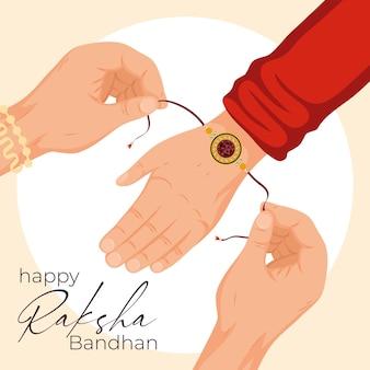 Braccialetto felice raksha bandhan a portata di mano su sfondo bianco