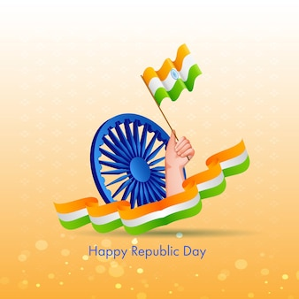 Felice festa della repubblica testo con ruota ashoka blu e mano che tiene la bandiera indiana su sfondo giallo bokeh.