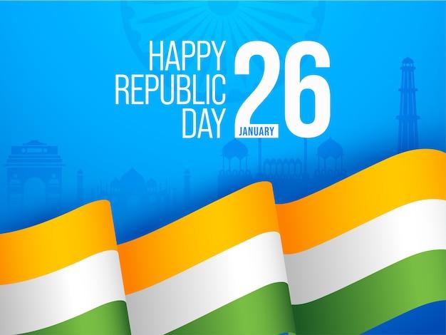 Testo di felice festa della repubblica con nastro tricolore ondulato su sfondo blu famoso monumento dell'india.
