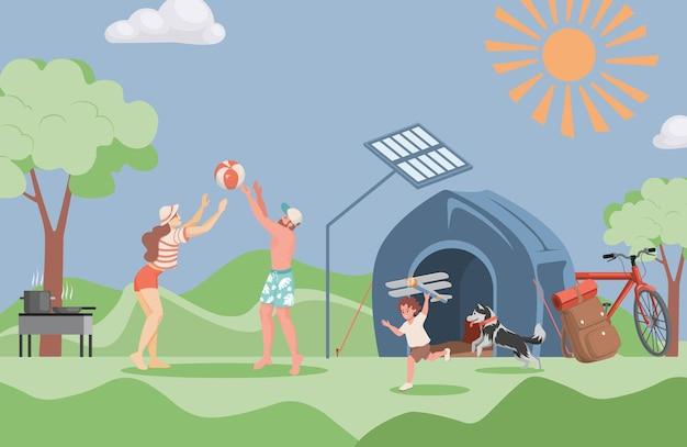 Famiglia sorridente felice che trascorre del tempo insieme all'aperto al campeggio estivo