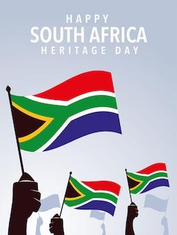 Felice giornata del patrimonio sudafricano, mani che tengono le bandiere dell'illustrazione del sud africa