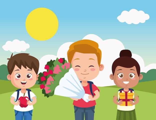 Scena del giorno dell'insegnante felice con i bambini degli studenti nel campo.