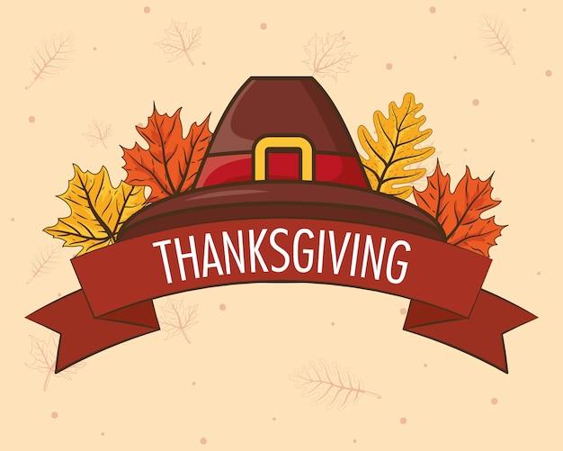 Testo di celebrazione del giorno del ringraziamento felice in nastro con foglie e cappello da pellegrino