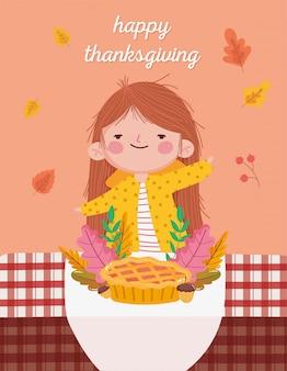 Ragazza sveglia felice di giorno di ringraziamento con la tovaglia delle ghiande della torta