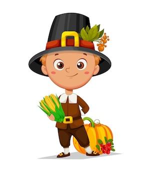Felice giorno del ringraziamento simpatico ragazzo pellegrino in piedi con zucca di mais e mirtillo rosso